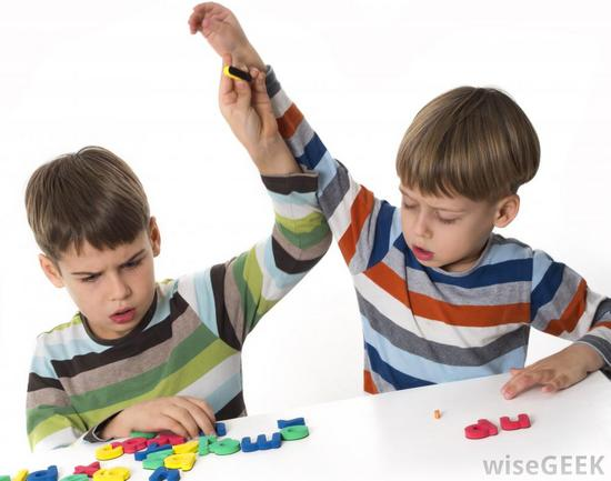 Two boys fighting over letters thumb