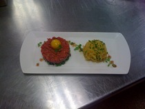 Steak tartar on a bed of micro greens with a nest of spaghetti squash sauted in brown butter cv