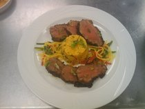 Coffee marinated venison tenderloin with a saffron infused jasmine rice accompanied with a sweet and spicy mango slaw cv