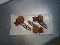Cayenne and pistachio coated scallops pan seared with a white balsamic raspberry reduction cv