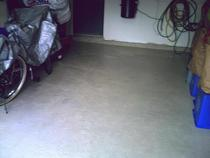 Repaired cemented and recoated garage floor and curb edge cv
