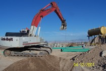 Backhoe lifting sewer pipe cv