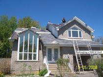 Reshingling roof 13112 hurtubise cv