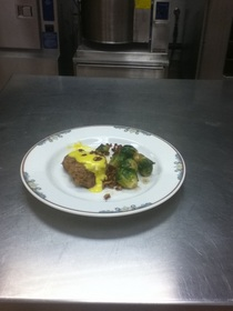 Pork with maltaise sauce with brussel sprouts and pecans cv
