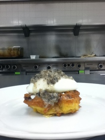 Crabcake with poached egg topped with mushroom sauce cv