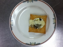 Puffed pastry with hard boiled egg onions mushrooms topped with bechalmel sauce cv