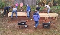 Volunteer group installing raised garden beds cv