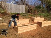 Chad raking raised garden beds cv