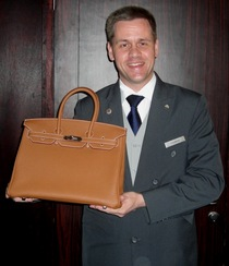 Thomas with birkin bag ar raffles dubai cv