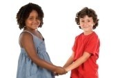 3460889 two handsome children of different races with their hands together cv