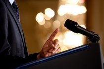 0519 0908 0820 3533 close up of a man making a point during a speech microphone and podium in view m 1  cv