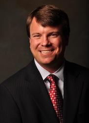 Justin L.  Smith
